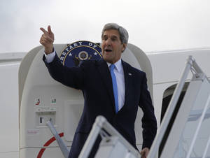 "Photo - U.S. Secretary of State John Kerry steps aboard his aircraft in Geneva, Switzerland, Sunday Nov. 10, 2013. Nuclear talks with Iran have failed to reach agreement, but Kerry said differences between Tehran and six world powers made ""significant progress."" (AP Photo/Jason Reed, Pool)"