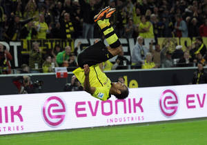 Photo - In this picture taken Sept. 14, 2013, Dortmund's Pierre-Emerick Aubameyang cheers after scoring during the Bundesliga soccer match between Borussia Dortmund and Hamburg SV in Dortmund, Germany.   (AP Photo/dpa,Friso Gentsch)
