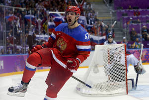 Photo - Russia forward Alexander Radulov reacts after scoring a goal in a shootout against Slovakia goaltender Jan Laco during overtime of a men's ice hockey game at the 2014 Winter Olympics, Sunday, Feb. 16, 2014, in Sochi, Russia. Russia won 1-0. (AP Photo/Mark Humphrey)