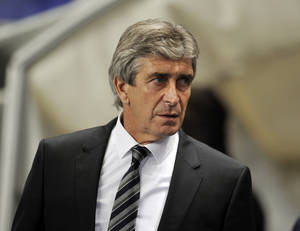 Photo - Manchester City manager Manuel Pellegrini during their Champions League Group D soccer match against Viktoria Plzen at the Etihad Stadium in Manchester, England, Wednesday, Nov. 27, 2013. (AP Photo/Clint Hughes)