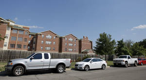 Photo - Cars park along Redwood Drive  in the Westwood neighborhood before a football game between Oklahoma State University and Savannah State University at Boone Pickens Stadium . Photo by Sarah Phipps, The Oklahoman <strong>SARAH PHIPPS - SARAH PHIPPS</strong>
