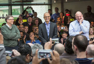Photo - Satya Nadella, Microsoft's new CEO, addresses employees along with Bill Gates and Steve Ballmer on the company's Redmond, Wash., campus.                    PRNewsFoto
