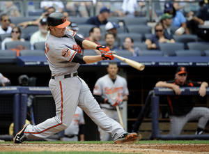 Photo -   Baltimore Orioles' Mark Reynolds hits a three-run home run off New York Yankees starting pitcher Phil Hughes in the sixth inning of a baseball game on Sunday, Sept. 2, 2012, at Yankee Stadium in New York. (AP Photo/Kathy Kmonicek)