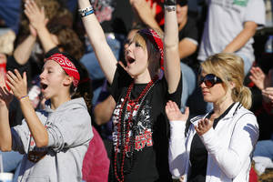 Photo - Cherokee fans Mollie Hawkins, Jaylyn Packard and Carson Tullis cheer during the Class B football semifinal between the Dewar Dragons and the Cherokee Chiefs at Robert Kalsu Stadium on Saturday, Nov. 27, 2010, in Del City, Okla.  Photo by Steve Sisney, The Oklahoman