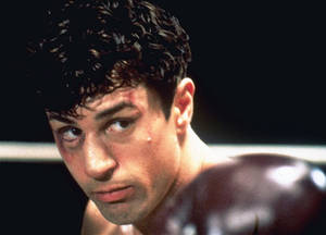 "Photo - FILE - This 1980 file photo showing Robert De Niro as Jake La Motta in a boxing scene from Martin Scorsese's film ""Raging Bull.""  (AP Photo, File)"