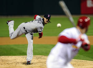 Photo - Boston Red Sox starting pitcher Clay Buchholz throws during the first inning of Game 4 of baseball's World Series against the St. Louis Cardinals  Sunday, Oct. 27, 2013, in St. Louis. (AP Photo/Jeff Curry, Pool)