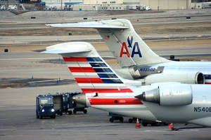 Photo -  Crews work around two American Airlines jets in St. Louis. AP File Photo  <strong>Bill Montgomery -  AP </strong>