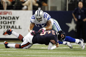 Photo -   Dallas Cowboys defensive end Jason Hatcher (97) lands on Chicago Bears quarterback Jay Cutler (6) after Cutler was sacked by Cowboys' DeMarcus Ware during the first half of an NFL football game, Monday, Oct. 1, 2012, in Arlington, Texas. (AP Photo/LM Otero)