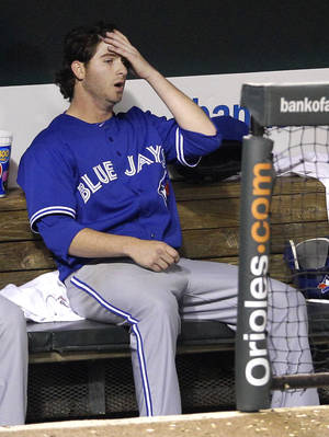 Photo -   Toronto Blue Jays starting pitcher Drew Hutchison sits in the dugout after leaving the baseball game in the sixth inning against the Baltimore Orioles in Baltimore, Thursday, April 26, 2012. Baltimore won 5-2. (AP Photo/Patrick Semansky)