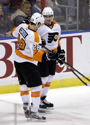photo - Philadelphia Flyers' Matt Read, right, is congratulated by Claude Giroux (28) after Read scored against the Florida Panthers during the second period of an NHL hockey   game in Sunrise, Fla., Saturday, Jan. 26, 2013. The Flyers won 7-1. (AP Photo/Alan Diaz)