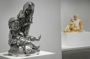 """Photo - Jeff Koons sculptures """"Two Kids,"""" left, and """"Michael Jackson and Bubbles,"""" right, are among works spanning his 30-year career, being installed at the Whitney Museum of American Art on Monday, June 23, 2014, in New York. """"Jeff Koons: A Retrospective,"""" marks the final exhibition at the Whitney's uptown Manhattan location from June 27 through Oct. 19. (AP Photo/Bebeto Matthews)"""