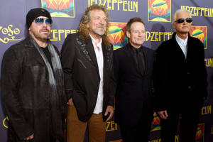 "Photo - FILE - This Oct. 9, 2012 file photo shows Led Zeppelin members, from left, Jason Bonham, Robert Plant, Jimmy Page and John Paul Jones at the ""Led Zeppelin: Celebration Day"" premiere in New York. Spotify has launched a new free streaming service for mobile devices. Spotify also announced that it is streaming the entire Led Zeppelin catalog. (Photo by Dario Cantatore/Invision/AP, File)"
