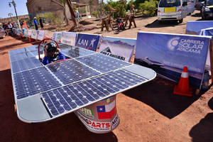 Photo -   In this photo released by Carrera Solar Atacama 2012, a driver sits in his solar powered car from the team Condor 2 Mining Parts at the start of the first phase of a race, in Humberstone in the area of Pozo Almonte, Chile, Thursday, Nov. 15, 2012. Most participants belong to universities and an entry rule is that cars cannot cost more then $7,000 dollars. (AP Photo/Carrera Solar Atacama 2012)