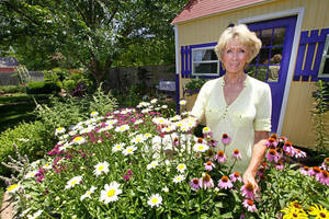 Photo - Master Gardener Anne Griswold in her back yard at her home in Edmond.  <strong>David McDaniel - The Oklahoman</strong>