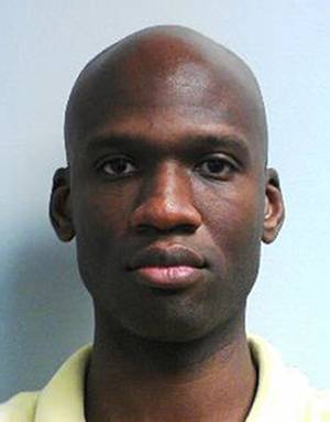 Photo - This image released by the FBI shows a photo of Washington Navy Yard gunman Aaron Alexis. Alexis, who killed 12 people in last year's rampage at Washington's Navy Yard lied so convincingly to Veterans Affairs doctors before the shootings that they concluded he had no mental health issues despite serious problems and encounters with police during the same period, according to a review by The Associated Press of his confidential medical files. (AP Photo/FBI)