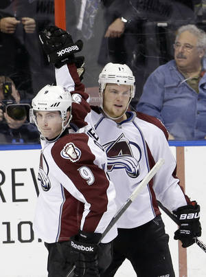 Photo - Colorado Avalanche left wing Jamie McGinn (11) is congratulated by teammate Matt Duchene (9) after McGinn scored against the Florida Panthers during the second period of an NHL hockey game in Sunrise, Fla., Friday, Jan. 24, 2014. (AP Photo/Alan Diaz)