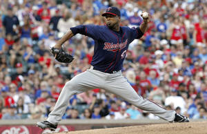 Photo -   Minnesota Twins starting pitcher Francisco Liriano throws during the first inning of a baseball game against the Texas Rangers, Friday, July 6, 2012, in Arlington, Texas. (AP Photo/LM Otero)