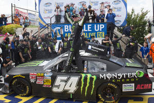 Photo - Kyle Busch celebrates in Victory Lane after winning the NASCAR Nationwide series auto race, Saturday, May 31, 2014, at Dover International Speedway in Dover, Del. (AP Photo/Molly Riley)