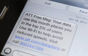 Photo - This Feb. 10, 2012 photo shows screen on a smartphone showing a text message to an AT&T customer, in New York. An AT&T subscriber heads to small claims court Friday, Feb. 24, 2012,in Simi Valley, Calif., to sue the company for slowing his iPhone's data service to the point where it hardly works.(AP Photo/Mark Lennihan) ORG XMIT: NYML201