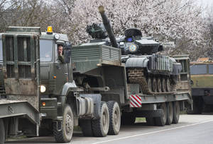 Photo - Ukrainian tanks are transported from their base in Perevalnoe, outside Simferopol, Crimea, Wednesday, March 26, 2014. Ukraine has started withdrawing its troops and weapons from Crimea, now controlled by Russia. (AP Photo/Pavel Golovkin)