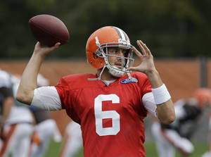 Photo - Cleveland Browns quarterback Brian Hoyer passes during NFL Football practice at the team's training facility in Berea, Ohio Wednesday, Sept. 18, 2013. Hoyer will start Sunday against Minnesota in place of injured Brandon Weeden, who sprained his right thumb last week and could be sidelined for several games. (AP Photo/Mark Duncan)