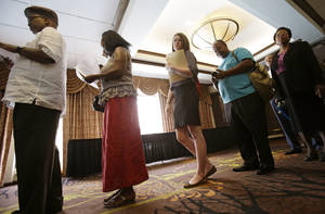 Photo - In this Thursday, June 12, 2014 photo, people wait in line for the Cleveland Career Fair in Independence, Ohio. The Labor Department releases employment data for June on Thursday, July 3, 2014. (AP Photo/Tony Dejak)