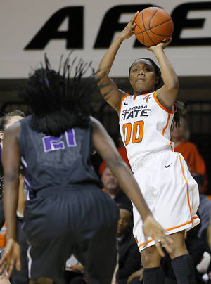 Photo - Oklahoma State's Roshunda Johnson (00) shoots the ball during a women's NCAA college basketball game between Oklahoma State University (OSU) and TCU at Gallagher-Iba Arena in Stillwater, Okla., Tuesday, Jan. 14, 2014. Oklahoma State won 65-53. Photo by Bryan Terry, The Oklahoman
