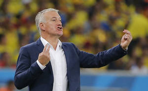 Photo - France's head coach Didier Deschamps directs his players during the group E World Cup soccer match between Ecuador and France at the Maracana stadium in Rio de Janeiro, Brazil, Wednesday, June 25, 2014. (AP Photo/David Vincent)