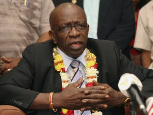 Photo - FILE - In this Thursday, June 2, 2011 file photo, suspended FIFA executive Jack Warner gestures during a news conference held shortly after his arrival at the airport in Port-of-Spain, in his native Trinidad and Tobago. Organizers of the 2022 World Cup in Qatar have distanced themselves from fresh allegations of corruption surrounding the Gulf nation's winning bid for the tournament in 2010. The Tuesday March 18, 2014  edition of British newspaper The Daily Telegraph alleges it has evidence that former FIFA vice president Jack Warner and his family were paid almost $2 million from a company controlled by Mohamed Bin Hammam, a Qatari who used to be an executive committee member of world football's governing body.  (AP Photo/Shirley Bahadur, File)