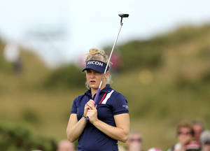 Photo - England's Charley Hull reacts after a putt on the 9th green during the third day of the Women's British Open golf championship on the Royal Birkdale Golf Club in Southport, England, Saturday, July 12, 2014. (AP Photo/Scott Heppell)