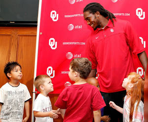 "Photo - OU defensive back Quinton Carter was named to the AFCA Good Works team on Tuesday. Carter was surprised with the award by a class of children Carter ""adopted"" from a local KinderCare day care. PHOTO COURTESY OU SPORTS INFORMATION"