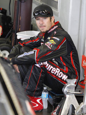 Photo - Martin Truex Jr waist by his car before practice for Sunday's NASCAR Daytona 500 Sprint Cup series auto race at Daytona International Speedway in Daytona Beach, Fla., Saturday, Feb. 22, 2014. (AP Photo/Terry Renna)