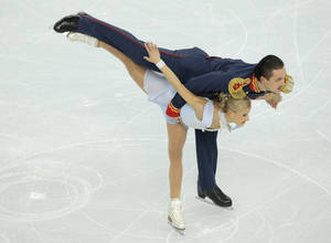 Photo - Tatiana Volosozhar and Maxim Trankov of Russia compete in the team pairs short program figure skating competition at the Iceberg Skating Palace during the 2014 Winter Olympics, Thursday, Feb. 6, 2014, in Sochi, Russia. (AP Photo/Vadim Ghirda)
