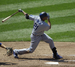 Photo -   Los Angeles Dodgers' Juan Rivera (21) hits a fourth-inning two-run home run off New York Mets starting pitcher Jonathon Niese in their baseball game at Citi Field in New York, Sunday, July 22, 2012. (AP Photo/Kathy Willens)