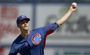 Photo - Chicago Cubs starting pitcher Chris Rusin delivers a pitch during the first inning of a spring exhibition baseball game against the New York Mets Sunday, March 16, 2014, in Las Vegas. (AP Photo/Isaac Brekken)