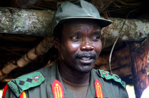 Photo -   FILE - This July 31, 2006 file photo shows Joseph Kony, leader of the Lord's Resistance Army, during a meeting with a delegation of 160 officials and lawmakers from northern Uganda and representatives of non-governmental organizations in Congo near the Sudan border. On Thursday, April 5, 2012, San Diego-based Invisible Children, the California group that produced the wildly popular video that turned Kony into a household name, posted a sequal on the Internet, Kony2012 Part II. (AP Photo, File)