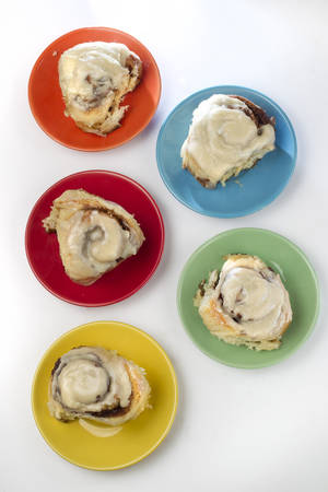 Photo - Swedes like their cinnamon rolls on the spicy side, Judith Fertig says. These cute, compact sweets get their kick from aromatic cardamom and taste great with coffee.  (Tammy Ljungblad/Kansas City Star/MCT)