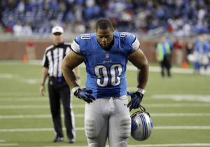 Photo - Detroit Lions defensive tackle Ndamukong Suh (90) walks off the field after the Lions lose 35-33 to the Indianapolis Colts in an NFL football game at Ford Field in Detroit, Sunday, Dec. 2, 2012. (AP Photo/Paul Sancya)