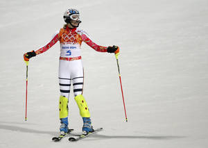 Photo - Germany's Maria Hoefl-Riesch reacts after finishing the second run of the women's slalom at the Sochi 2014 Winter Olympics, Friday, Feb. 21, 2014, in Krasnaya Polyana, Russia.  (AP Photo/Christophe Ena)