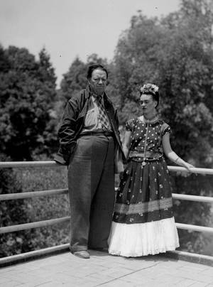 "Photo - FILE - This April 13, 1939 file photo shows Mexican muralist Diego Rivera and his artist wife Frida Kahlo at their home in Mexico City. The Detroit Institute of Arts announced Monday, May 5, 2014, that it is planning an exhibition for next year that focuses on the period between April 1932 and March 1933, which the museum refers to as ""a pivotal turning point in each artist's career."" The show, which is scheduled to run from March 15, 2015, through July 12, 2015, will feature 80 artworks, including Rivera's preparatory drawings for the Detroit Industry murals. (AP Photo, File)"