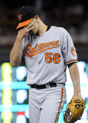 Photo -   Baltimore Orioles pitcher Darren O'Day leaves the game after giving up the third run of the sixth inning to the Minnesota Twins, Monday, July 16, 2012, in Minneapolis. The Twins won 19-7. (AP Photo/Jim Mone)