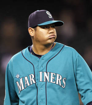 Photo -   Seattle Mariners starting pitcher Felix Hernandez heads off the field after being relieved against the Los Angeles Angels in the sixth inning of a baseball game Monday, Oct. 1, 2012, in Seattle. The start was Hernandez's last of the year. (AP Photo/Elaine Thompson)