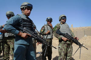"photo -   In this June 19, 2012 file photo, Afghan soldiers and a policeman prepare for a mock ambush as part of a training exercise at the U.S. Marine-run Joint Sustainment Academy, Camp Leatherneck in Helmand, south of Kabul. The U.S. suspects the Haqqani insurgent network, which has ties to al-Qaida and is based in Pakistan, is a driving force behind many of the ""insider"" attacks by Afghan forces that have killed more than 50 U.S. and allied troops this year, officials say. Until now, officials have said the attacks seemed to stem either from personal grievances against the allies or from Taliban infiltration. (AP Photo/Heidi Vogt)"
