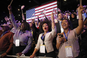 Photo -   Supporters of President Barack Obama react to favorable media projections at the McCormick Place during an election night watch party in Chicago on Tuesday, Nov. 6, 2012. (AP Photo/Jerome Delay)