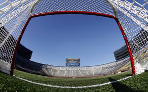 Photo -   FILE - In this Feb. 9, 2012, file photo, a view from inside a hockey net shows Michigan Stadium in Ann Arbor, Mich., after the announcement of the NHL Winter Classic hockey game. The NHL has canceled the 2013 Winter Classic at Michigan Stadium. The signature event between the Detroit Red Wings and Toronto Maple Leafs, is the latest casualty from the labor dispute that has put the season on hold, a person familiar with the situation told The Associated Press on Friday, Nov. 2, 2012. (AP Photo/Paul Sancya, File)
