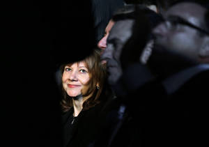 Photo - FILE - In this Monday, Jan. 13, 2014, file photo incoming General Motors CEO Mary Barra watches the North American Truck of the Year and Car of the Year awards at the North American International Auto Show in Detroit. General Motors reports quarterly earnings on Thursday, Feb. 6,  2014 (AP Photo/Paul Sancya)