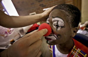 Photo - Henry Peoples has his clown nose attached before dress rehearsal for the Circus of the Kids.
