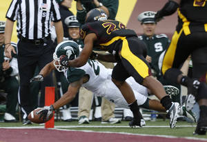 photo -   Michigan State's Nick Hill, left, dives into the end zone against Central Michigan's Leron Eaddy (24) during the fourth quarter of an NCAA college football game on Saturday, Sept. 8, 2012, in Mount Pleasant, Mich. The play was called back due to a penalty but Hill scored later in the series. Michigan State won 41-7. (AP Photo/Al Goldis)