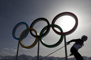 Photo - FILE - In this file photo dated Thursday, Feb. 20, 2014, a skier passes by the Olympic rings at the 2014 Winter Olympics, in Krasnaya Polyana, Russia. Overshadowed by the international crisis over Ukraine, Russia welcomes the sporting world back to Sochi this week for the Winter Paralympics that will be snubbed by some politicians and will struggle to match the successful Winter Olympics that ended less than two weeks ago in the Russian Black Sea resort. (AP Photo/Felipe Dana, FILE)