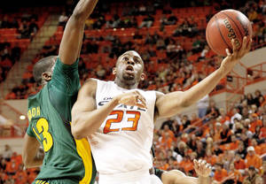 Photo - Oklahoma State's James Anderson goes past Baylor's Ekpe Udoh during the Cowboys' win Saturday.  Photos by Bryan Terry, The Oklahoman
